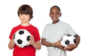 stock photo of children playing  - Two adorable children with balls on a over white background - JPG