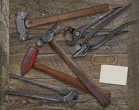 stock photo of blacksmith shop  - vintage blacksmith or metalwork tools over wooden bench - JPG