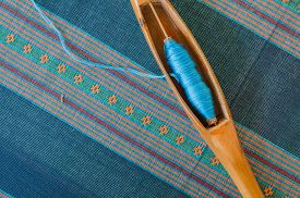 picture of handloom  - Blue Cotton Insert A Shuttle on a fabric - JPG