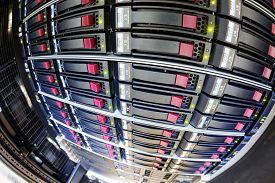 foto of supercomputer  - detail of modern hi tech data server in network center - JPG