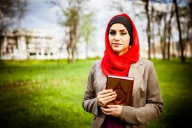 pic of muslim  - beautiful muslim woman wearing hijab and holding the Koran  - JPG