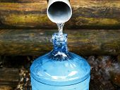 picture of groundwater  - source of spring water source  in plastic bottle - JPG