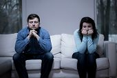 image of argument  - Couple after argument sitting on the sofa - JPG