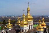 stock photo of kiev  - kiev pechersk lavra and its beautiful golden domes of uspenskiy cathedral - JPG