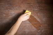 picture of house cleaning  - Cleaning dust from the wood in house - JPG
