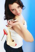 picture of woman boots  - red beige female shoes boots high heels in woman hand on blue - JPG