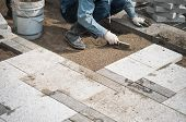 picture of pavestone  - Construction worker installing the pavestone on the road - JPG