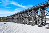 image of trestle bridge  - View of the Pudding Creek Trestle on the beach of Fort Bragg - JPG