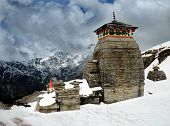 stock photo of shiva  - Tungnath is the temple of Lord Shiva is located on a mountain ridge Tungnath in the state of Uttarakhand India - JPG