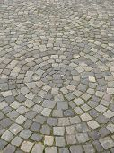 foto of paving  - urban paving made of brics arranged in concentric circles - JPG