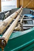 stock photo of mast  - Masts on a green boat in a ship builder - JPG