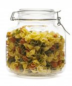 stock photo of glass noodles  - Farfalle pasta inside glass jar isolated on a white background - JPG
