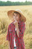 picture of oats  - Smiling teenage farmerin wide - JPG