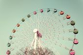 stock photo of color wheel  - Colorful Giant ferris wheel against Vintage style - JPG