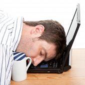 Businessman Asleep At His Computer