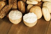 pic of whole-wheat  - Assortment of whole wnd white wheat bread on wooden table - JPG