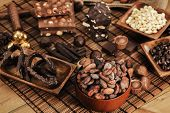 picture of cocoa beans  - Cocoa beans and chocolate assortment on table - JPG