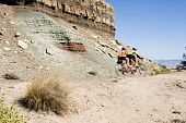 picture of semi-arid  - A couple ride a tandem bike through the scenery along the Rim Rock Drive in Colorado National Park - JPG