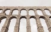 foto of aqueduct  - an old stone aqueduct in Segovia Spain - JPG