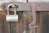 stock photo of pick-lock  - ordinary lock and rusty hook close and save door - JPG