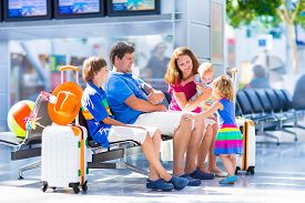picture of big-girls  - Big happy family with three kids traveling by airplane at Dusseldorf International airport parents with teenager boy toddler girl and little baby holding colorful luggage for summer beach vacation - JPG