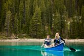 picture of copulation  - A portrait of a happy copule in a canoe on a glacial lake - JPG