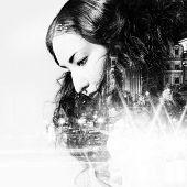 Постер, плакат: Double exposure of beautiful girl and city lights at night black and white toning