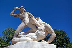 stock photo of minotaur  - Beautiful marble sculpture of Theseus slaying Minotaur - JPG