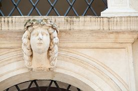 stock photo of vicenza  - White stone mascaron on the entrance door arch of a historical palace of Vicenza - JPG