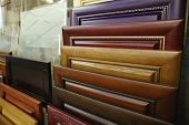 Assortment of wooden samples for furniture in hardware store, closeup poster