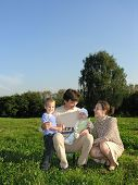 Family Of Four On Grass Wood Blue Sky Without Clouds Sit Smile poster