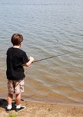 Young Boy Fishing.