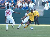CARSON, CA. - JULY 3: Concacaf Gold Cup soccer match, Canada vs. Jamaica at the Home Depot center in Carson. Luton Shelton dribbles the ball while Patrice Bernier and Paul Stalteri defend on July 3, 2009.