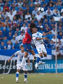 CARSON, CA. - JULY 3: Concacaf Gold Cup soccer match, Costa Rica vs. El Salvador at the Home Depot center in Carson. William Reyes and Celso Borges up in the air for a header on July 3, 2009.