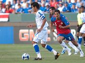CARSON, CA. - JULY 3: Concacaf Gold Cup soccer match, Costa Rica vs. El Salvador at the Home Depot Center in Carson. Ramon Sanchez dribbles the ball while Celso Borges pursues. July 3, 2009.