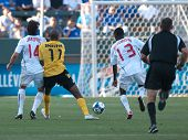 CARSON, CA. - JULY 3: Concacaf Gold Cup soccer match, Canada vs. Jamaica at the Home Depot Center in Carson. Dejan Jakovic, Luton Shelton, and Atiba Hutchinson. July 3, 2009.