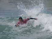 HUNTINGTON BEACH, CA. - JULY 26: Adriano de Souza competing at the Hurley US Open of Surfing in Hunt