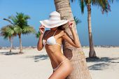 Sexy Beautiful Unrecognizable Tanned Woman Relaxing And Sunbathing In Bikini On Sea Background And P poster