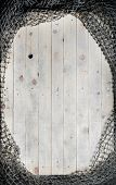 Fishing nets still-life on the wooden background.   poster