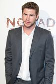 SANTA MONICA, CA. - FEB 22: Australian actor Liam Hemsworth arrives at the Nomad Two Worlds Los Angeles debut gala at 59 Pier Studios West on Feb 22, 2011 in Santa Monica, CA.