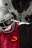 High angle view of chest protector with sports uniform by helmet poster
