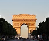 stock photo of matinee  - The Arc de Triomphe at sunrise - JPG