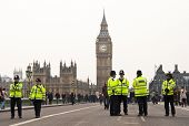 LONDON, UK - MARCH 26: Police officers during the march in central London against public spending cu