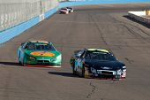 AVONDALE, AZ - NOV 7: Bobby Hamilton Jr. (25) and Morgan Shepherd (89) compete in the NASCAR Nationw