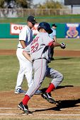 MESA, AZ - NOV 20: Josh Reddick of  the Scottsdale Scorpions rounds first  in the Arizona Fall League game with the Mesa Solar Sox on November 20, 2008 in Mesa, Arizona.