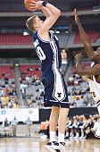 GLENDALE, AZ - DECEMBER 20: Brigham Young University forward Lee Cummard #30 puts up a jump shot dur