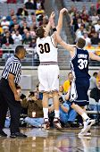 GLENDALE, AZ - DECEMBER 20: Rihards Kuksiks #30 of Arizona State University shoots over Lee Cummard