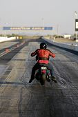 CHANDLER, AZ - APRIL 25: A motorcycle competes on the drag strip at Firebird International Raceway on April 25, 2009 in Chandler, AZ.