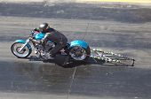 CHANDLER, AZ - OCTOBER 2: A motorcycle competes in the NHRA Pacific Division drag racing championshi