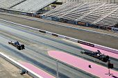 CHANDLER, AZ - OCTOBER 2: Dragsters compete in the NHRA Pacific Division drag racing championship on